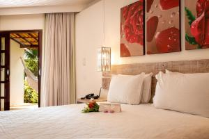 A bed or beds in a room at Acquapipa Resort