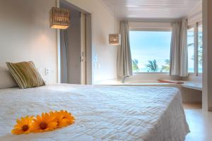 A bed or beds in a room at Pipa Privilege Suítes