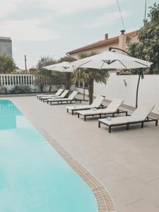 The swimming pool at or close to Hotel Orion