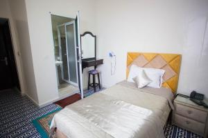 A bed or beds in a room at Hotel Mamora Tanger