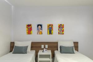 Кровать или кровати в номере Citi Hotel Express Caruaru