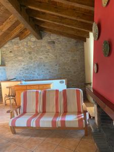 A bed or beds in a room at Ca L'Isidret