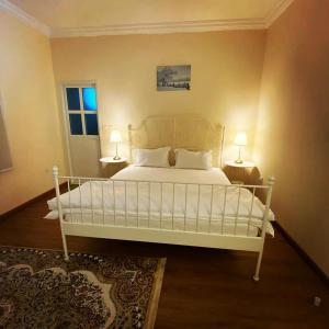 A bed or beds in a room at Al Reef Rest House