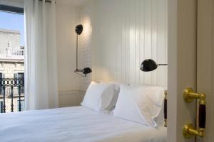 Ein Bett oder Betten in einem Zimmer der Unterkunft Praktik Bakery