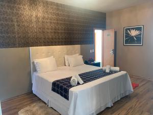 Cama ou camas em um quarto em Splendore Hotel