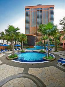 The swimming pool at or close to Grand Service Apartment @ Times Square