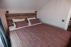 A bed or beds in a room at Studio in Gelendzhik