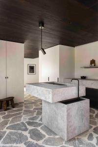 A kitchen or kitchenette at Mud Residence