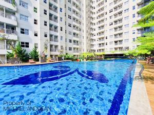 The swimming pool at or close to Aya Stays 3 at Parahyangan Residence