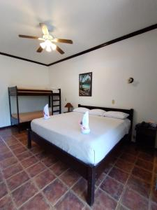A bed or beds in a room at The Backyard Beachfront Hotel
