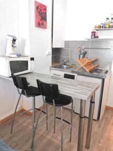 A kitchen or kitchenette at MySofa'da studio hypercentre ALL INCLUSIVE