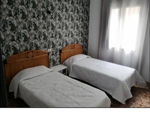 Cama o camas de una habitación en Alcaravaneras Hostel