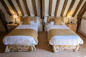 A bed or beds in a room at Waveney House Hotel