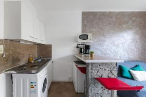 A kitchen or kitchenette at Nice & calm studio w balcony at the heart of Prado in Marseille - Welkeys