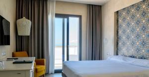 Letto o letti in una camera di Villa Fiorita Boutique Hotel