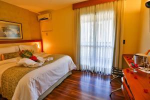 Cama ou camas em um quarto em Metropolitan Hotel Brasília