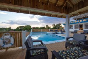 The swimming pool at or near Butterfly Hill Villa & Studio Apartment
