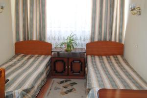 Кровать или кровати в номере Gostinitsa Yakimanka