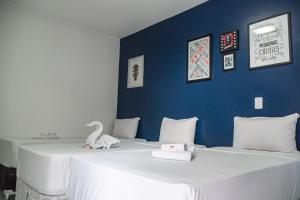A bed or beds in a room at Pousada Maceio Paradise