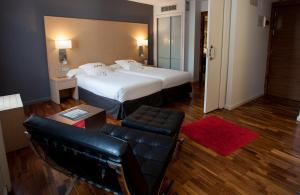 A bed or beds in a room at Eurostars Marqués de Vallejo