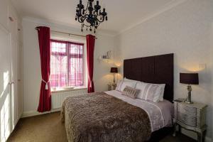 Кровать или кровати в номере Robertsbrook Guest House