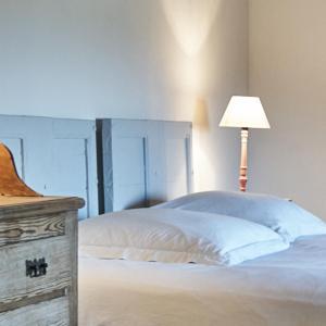Un ou plusieurs lits dans un hébergement de l'établissement La Cour du Marronnier