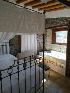 A bed or beds in a room at AgroSpito Traditional Guest House
