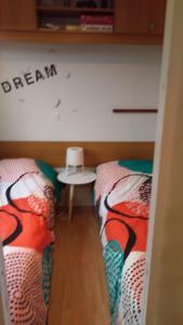 Un ou plusieurs lits dans un hébergement de l'établissement L'Horizon
