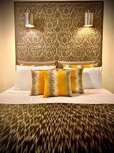 Een bed of bedden in een kamer bij La Maison Maure