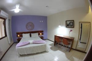 A bed or beds in a room at Espaço Nativo Pousada