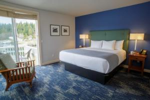 A bed or beds in a room at Resort at Port Ludlow