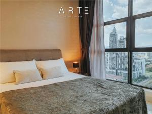 A bed or beds in a room at Arte Mont Kiara Luxury Suite