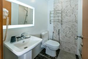 Ванная комната в Гелиос Отель