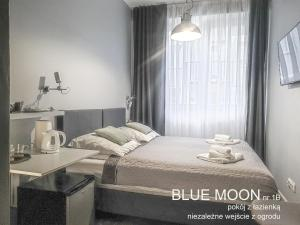 A bed or beds in a room at Chopina 29 Sopot Apartments
