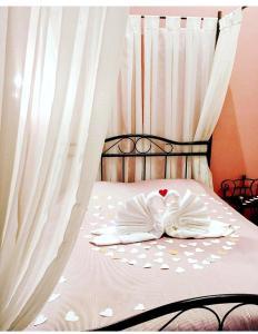 Кровать или кровати в номере Бутик-Премьера на Невском