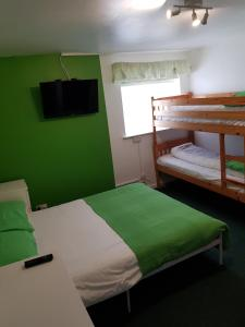 A bunk bed or bunk beds in a room at Oakleigh House