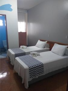 A bed or beds in a room at Eco Hotel