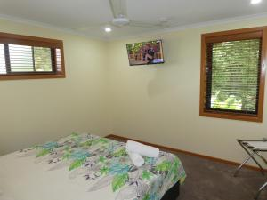 A bed or beds in a room at The Summit Rainforest Retreat