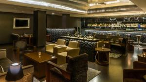 The lounge or bar area at The Claridges New Delhi