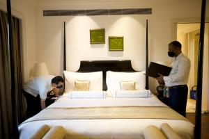 A bed or beds in a room at The Claridges New Delhi