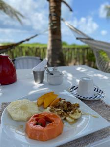 Breakfast options available to guests at Oca Ybápytanga