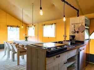 Een keuken of kitchenette bij Alluring Tent Lodge in Alphen with Hot Tub and Garden