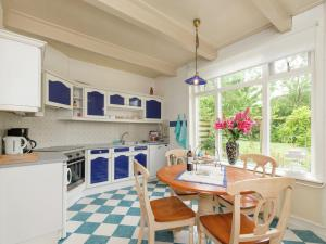 A kitchen or kitchenette at Fairy-tale Apartment in Oudesluis with private Swimming Pool