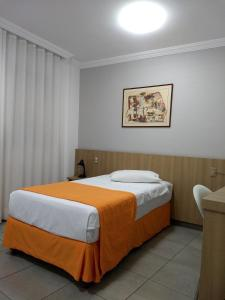A bed or beds in a room at Frimas Pampulha Hotel
