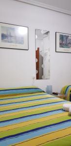 Cama o camas de una habitación en Pension Salamanca