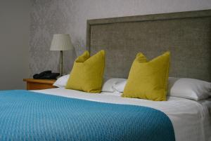 A bed or beds in a room at Stallingborough Grange Hotel