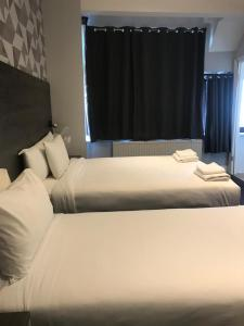 A bed or beds in a room at Casuarina Tree