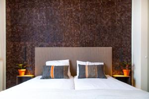 Un ou plusieurs lits dans un hébergement de l'établissement Hotel Pannenkoekhuis Vierwegen