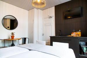 Ein Bett oder Betten in einem Zimmer der Unterkunft Hotel Pannenkoekhuis Vierwegen