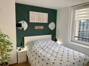 Un ou plusieurs lits dans un hébergement de l'établissement Au 4qK Studio 2 pers Strasbourg Kléber Halles